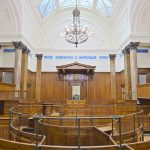 large court room for legal proceedings in rental agreements